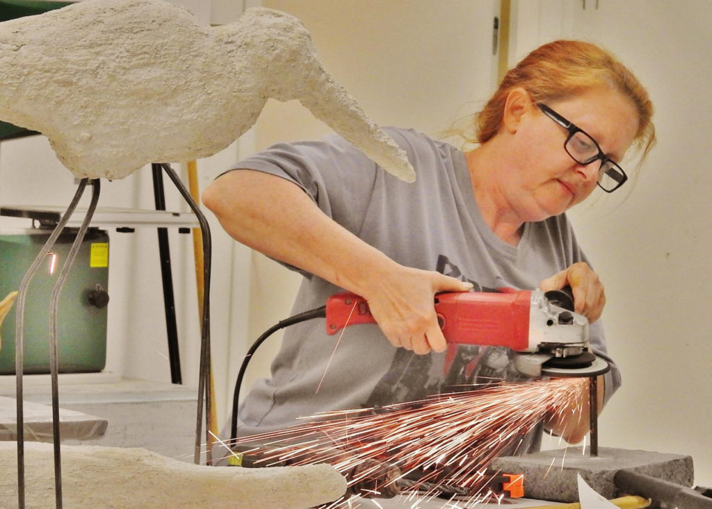 Teaching artist Angelique Lynch sculpts a bird during her class at the Johnson City Public Library in Tennessee.