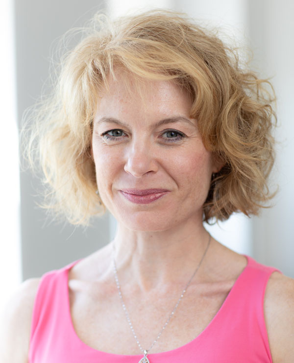 Headshot of Annie Montgomery, Lifetime Arts' Director of Education. She has blonde short hair and is smiling.