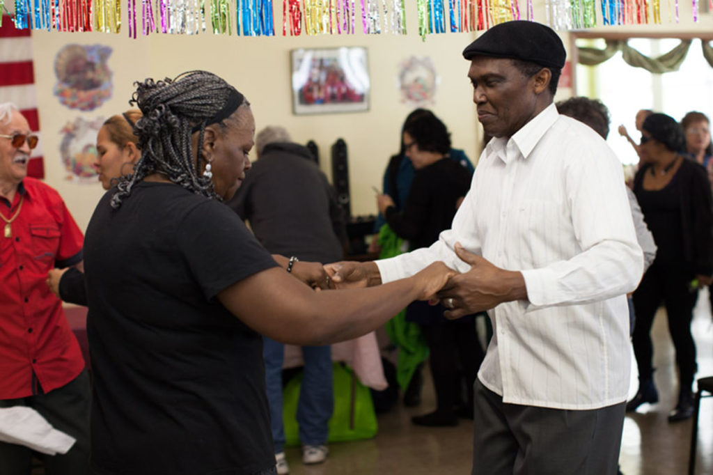Participants dancing together in a creative aging program offered at the Brooklyn Public Library in New York.