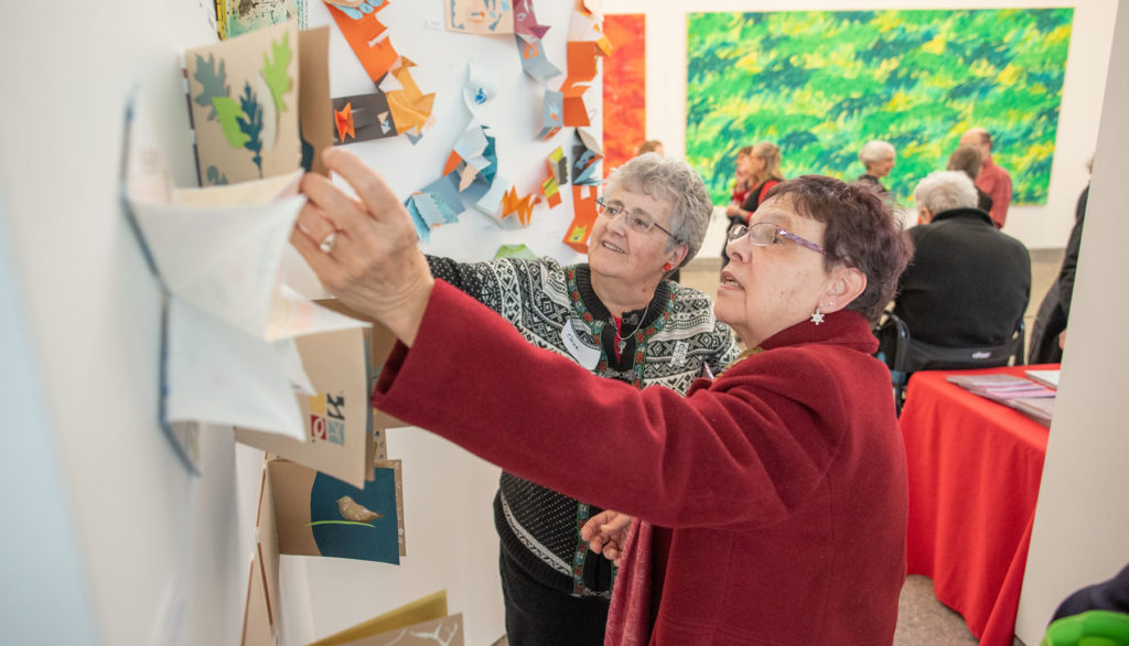 wo participants review artwork at the Eric Carle Museum of Picture Book Art in Massachusetts.