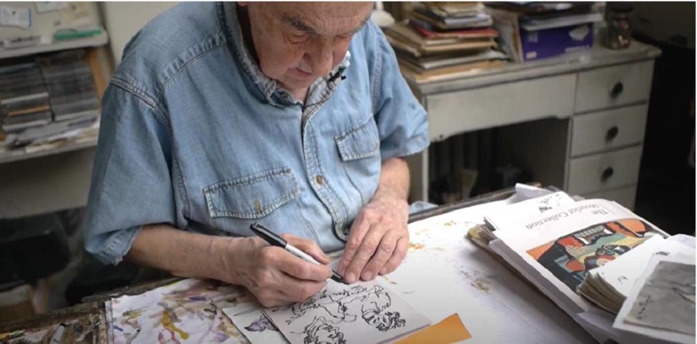 A screenshot of Hank, an older adult artist, working on an art project.