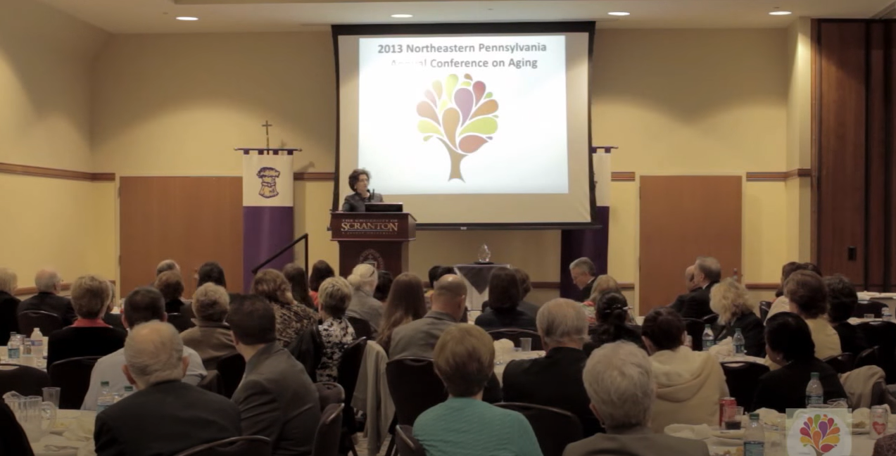 A screenshot of Linda Fried, Dean of Mailman School of Health, presenting at Conference on Aging at