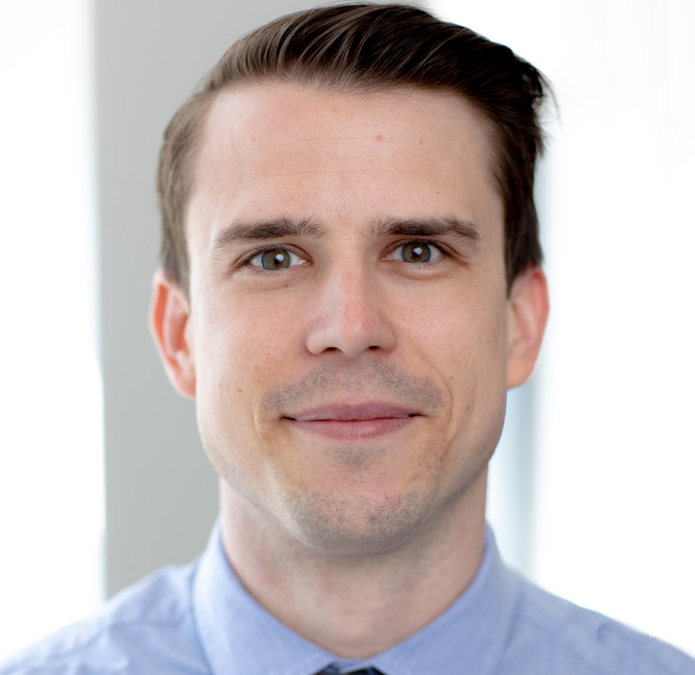 This is a headshot of Lifetime Arts' Deputy Director, Nathan Majaros. He has short brown hair and is smiling.