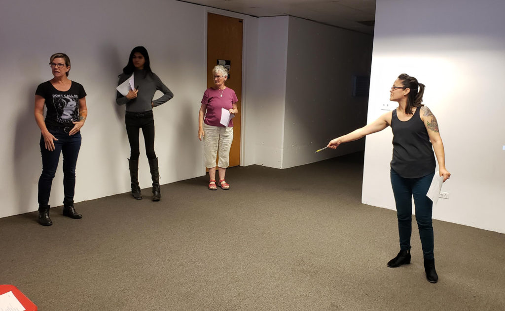 A group of three students of various ages and their instructor in a practice room at MOCA Tucson
