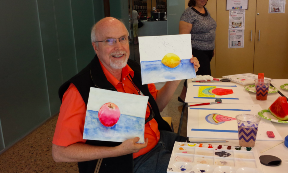 LAAN/Phoenix Public Library participant displaying finished watercolor works.