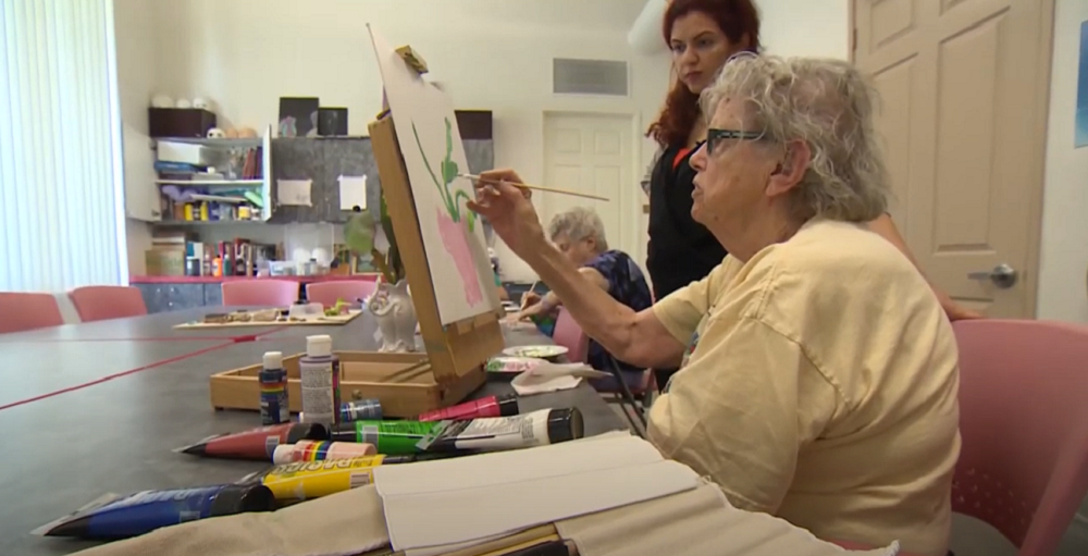 A screenshot of an older adult participant painting.