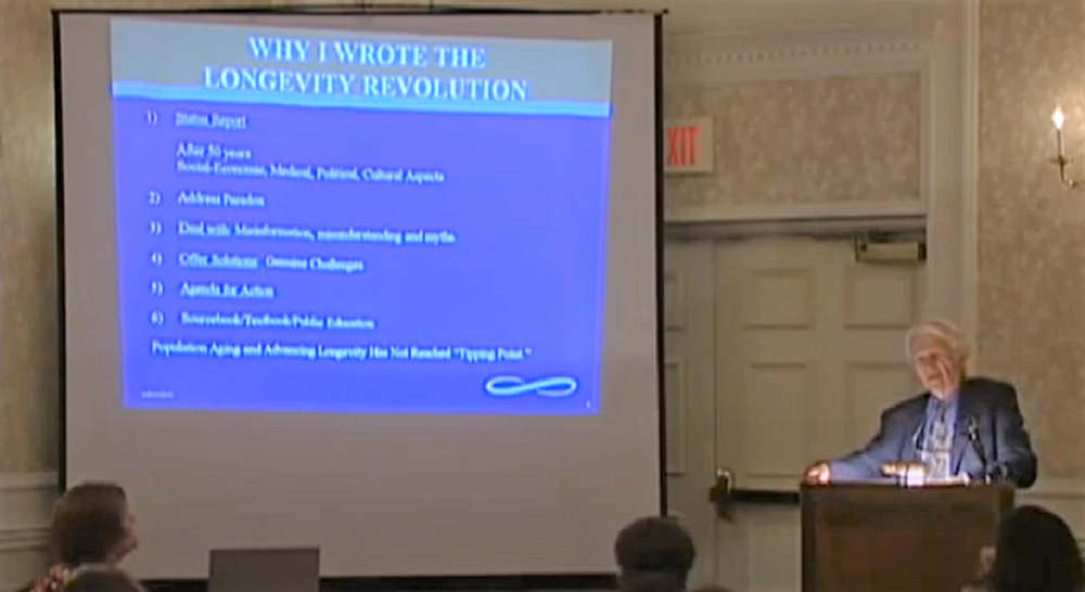A screenshot of Dr. Butler giving a keynote address.